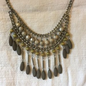 Gray and green statement necklace.